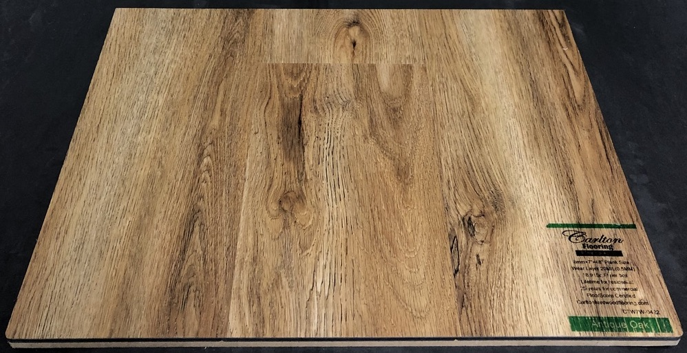 "Carlton Flooring - Prime Collection Product: Antique Oak Dimensions: 8mm x 7"" x 48"" (0.5mm Wear Layer) Underpad: Attached Warranty: Lifetime Residential - 25 Years Commercial FloorScore Certified"