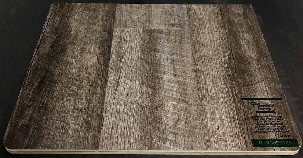"Carlton Flooring - Prime Collection Product: Manchester Dimensions: 6.5mm x 7"" x 48"" (0.5mm Wear Layer) Underpad: Attached Warranty: Lifetime Residential - 25 Years Commercial FloorScore Certified Code: CTS6501S"
